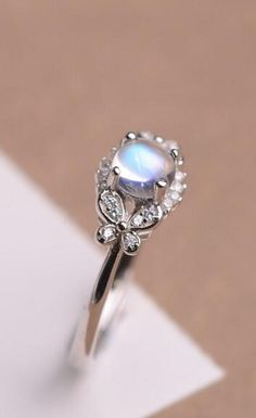 affordable chic design blue moonstone sterling silver engagement ring for her http://www.jewelsin.com/p-classic-brilliant-natural-round-blue-moonstone-dainty-women-ring-in-sterling-silver-1232