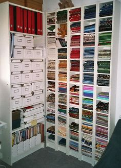 """Her Fabric Stash"" Ikea Billy and Boxes with finished projects like small embroidered items: potholders, tissue cases, embroidered cards, coin purses, etc. (mayangel_46/flickrphotostream. July 2009)"
