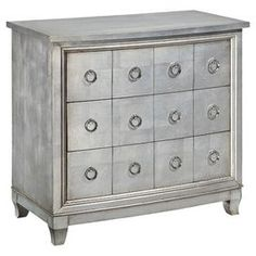 """An eye-catching addition to your living room or master suite, this 3-drawer chest features metal ring pulls and an apothecary-inspired design.     Product: ChestConstruction Material: Engineered wood, metal and poplar woodColor: Burnished silver Features: Three drawersRing pull hardwareApothecary-inspired designDimensions: 33"""" H x 36"""" W x 18"""" D"""