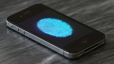 Was iOS 7's Lock Screen Redesigned For The iPhone 5S's Fingerprint Sensor? - Cult of Mac