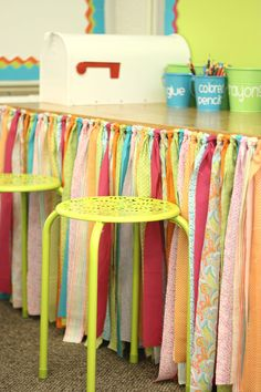 Sewing Curtains How to hide the clutter and create a cute, no-sew table skirt for your classroom. Don't miss this tutorial. - Learn how to make a no sew table skirt for you classroom or home with this simple tutorial from Differentiated Kindergarten. First Grade Classroom, New Classroom, Classroom Design, Classroom Ideas, Stools For Classroom, Preschool Classroom Layout, Classroom Projects, Reading Garden Classroom, Decorating Ideas For Classroom