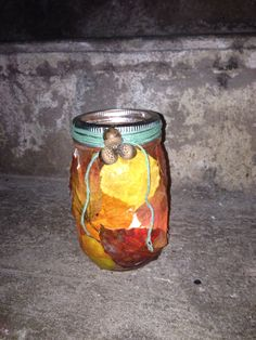 Real leafs, use a mason jar and make into a nice fall candle holder, u can use modge podge or hot glue gun, I used both, u can use a button or egg corns for middle  of lid after adding some ribbon or hema string