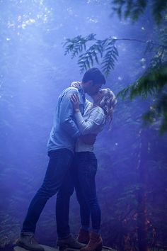 Had to share another photo from an engagement shoot I photographed!   We had such a great time playing with the smoke bombs at Pacific Spirit Park in Vancouver BC. I thought the deep purple would be a great contrast to the green of the forest. I'm glad they were up for it, as it gives off a colourful, ghosting effect. The effects don't last long so we were running beside the smoke as it was being carried by the wind, which made it even more exciting to deliver creative photos.