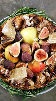 Have a sweet and fruitful new year with our apple challah cake topped with honey, figs, almonds and more!
