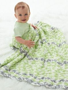 When it comes to crochet baby blanket patterns, the cuddlier the better. So if you happen to be looking around for an extra cuddly pattern, check out the Super Snugly Crochet Baby Blanket. This lime green ripple baby blanket is simple, soft, and snugly, everything that you could want in a crochet baby blanket.