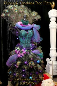 46 New Ideas Christmas Tree Purple Decorations Beautiful Mannequin Christmas Tree, Dress Form Christmas Tree, Peacock Christmas Tree, Holiday Tree, Xmas Tree, Christmas Holidays, Christmas Flowers, Coastal Christmas, Christmas Quotes