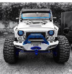 WHITE JEEP JK WITH BLUE TRIM AND NITTO MUD GRAPPLER TIRES