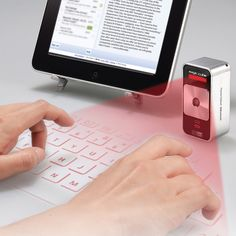 This is for reals! A projected keyboard to go with an iPad. 180 bucks.