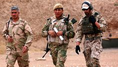German military experts instruct Kurdish Peshmerga fighters during training at a shooting range on October 2, 2014, in Arbil, the capital of the autonomous Kurdish region of northern Iraq. Iraq's foreign minister Ibrahim al-Jaafari said that foreign assistance in the fight against the Islamic State jihadist group should respect the country's sovereignty. AFP PHOTOS/SAFIN HAMED