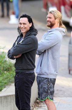 Loki in jeans and Thor wearing board shorts, both sporting hoodies... I probably died and went to Valhalla. XD