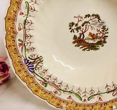 This is GORGEOUS!  VINTAGE ROYAL DOULTON MICHELHAM D6073 SOUP BOWL.  Its mighty PRETTY! The edging is scalloped and fluted and decorated with a buttery yellow profusion of flowers. Theres a center medallion of several trees in front of the ruins of a castle. Theres also bluebells and tulips twined with ribbon. This pattern was made in 1939 and discontinued in 1950.  https://www.etsy.com/listing/504449953 $45.00.