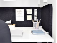 GALANT black screen attached to the desk and used as a notice board