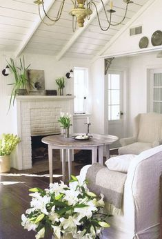 White walls feel fresh and the light furniture against the dark wood floor is very clean and grounding.