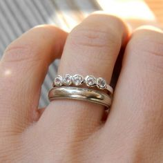 White Topaz  Five Stone Band Ring $248.00  I love the solid band with it, too.