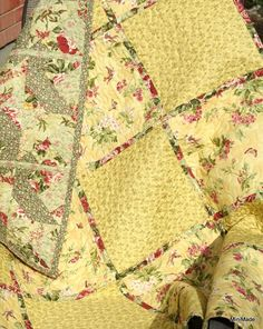 "Blocks are individually machine quilted to a print backing before joining them together with a narrow reversible sashing. The result is a reversible quilt with an intricate patchwork pattern on one side and a simpler block design on the other.  The quilt, consisting of twenty 10"" blocks, measures approximately 50 1/2"" by 40 1/2"".  $115 on Etsy.com."