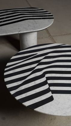 Spectacular marble coffee tables from Polish designer Olga Bielawska. Stripes of black and white marble are combined in an undulating pattern which leaves the table top looking as if it's draped in fabric.