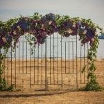 English Iron Gates available in Teal and Cream.  We love how gorgeous they look adored with these stunning purple, blue & green florals. #vintageambiance #weddingdecor