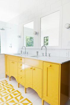 Yellow cupboards in bathroom