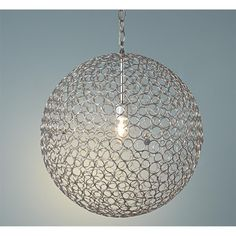 "Silver Circles Sphere Pendant Light  Steel rings form a globe around a central light. This simple, modern lantern will add a sophisticated touch to any decor. In 3 sizes to coordinate in different areas or use artistically mixed together. 100 watts. Small: (12.5"" Diameter) Medium: (16"" Diameter) Large: (18"" Diameter) 3' chain 5"" canopy    Product SKU: LA10036 SM  Price:  $99.00"