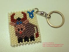 Beaded keychain with zodiac sign Taurus in even count peyote stitch. Free detailed tutorial.