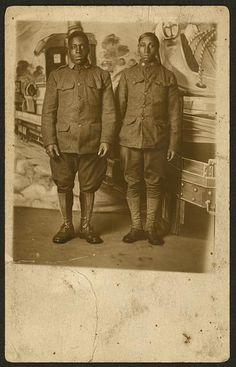 [World War I Infantry soldiers, standing in front of photographers backdrop]