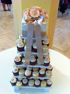 Cupcake cake, with a small cake top so there is something for the bride and groom to cut!