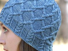 Ravelry: Grey Havens Hat pattern by Maria Olson, in sport weight, there is also a gorgeous matching cowl pattern available thru designer's pages on Ravelry
