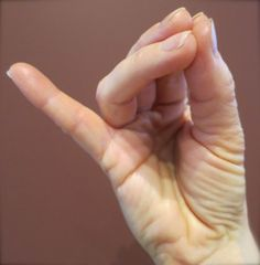 """Hansi Mudra allows the breath and energy to arise upwards to open heart and chest, as well as soften tension in the neck and head. This enhances uplifting energy, creating a positive mood and outlook. Cultivates innate but sometimes overlooked positive qualities. Enhances immunity, releases jaw tension (good for TMJ), and is lifting for depression. Hansi Mudra Affirmation: """"My inner smile awakens the bliss that is always present."""""""