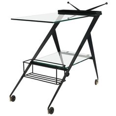 For Sale on - table on wheels by Angelo Ostuni. Atypical table on wheels with bottle holder, black lacquered folded metal based and handles decorated with amazing Serving Cart On Wheels, Sofa Table Design, Table Furniture, Furniture Storage, Large Table Lamps, 1950s Design, Dry Bars, Serving Table, Metal Shelves