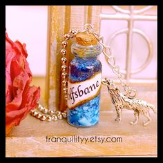 Wolsbane Necklace Harry Potter Inspired , glass vial  2ml Potion Bottle necklace By: Tranquilityy by tranquilityy on Etsy