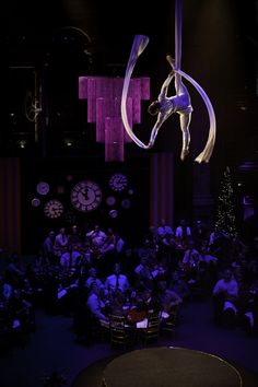 A stunning aerial silk act will captivate guests at your circus themed wedding.