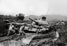 Soldiers and militia members working on the rain-drenched Ho Chi Minh trail to allow North Vietnams Russian T-54 tanks to make their way to the battlefront south of the liberated zone. 1972. (manhhai Flickr)