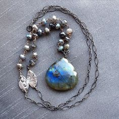 Labradorite Pendant Necklace // Oxidize Sterling by BitsofSilver ($82.00) A one-of-a kind statement necklace. With beautiful flashes of blues and greens, this Labradorite pendant hangs on a 30 in oxidized sterling silver chain with handmade marquise fine silver(.999%) connectors to complete the style.