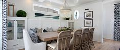 Neutral dining with pop of Schumacher fabric on windows!