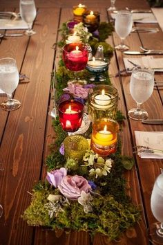 wedding centerpiece idea - moss + flower table runners with colorful candle votives