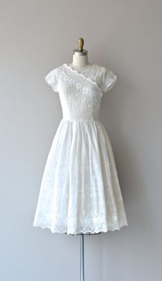 Vintage late 1940s sheer white organza dress with floral eyelet lace, short sleeves fitted waist, back button bodice and lower metal zipper. This dress is sheer and a slip is necessary (not included). --- M E A S U R E M E N T S ---  fits like: small bust: 34 waist: 25-26 hip: free length: 43 brand/maker: n/a condition: excellent  to ensure a good fit, please read the sizing guide: http://www.etsy.com/shop/DearGolden/policy  ✩ more vintage dresses ✩…