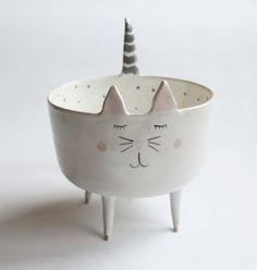 Marta Turowska is a Polish artist. Marta creates these fanciful ceramic bowls and plates that look like our favorite animals – cats, hedgehogs and whales.