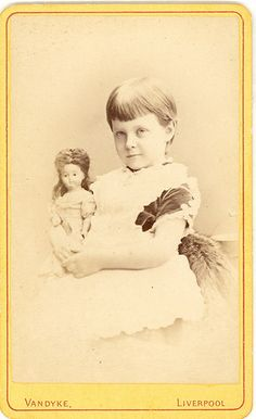 Girl and dolly - bisque head doll
