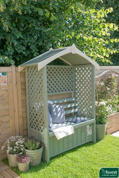Beautiful arbour with solid roof and lattice design side and back panels - perfect for climbing plants to create a garden sanctuary.