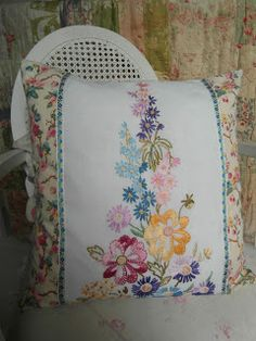 Vintage hand embroidered linen and floral fabric cushion