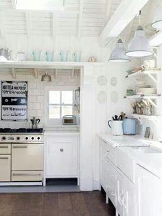Beach Cottage Kitchen: white palette, baby blue accent color, dark floor