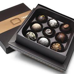 Handmade chocolate truffles in elegant packaging