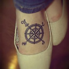 Compass foot tattoo