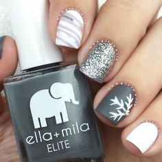 Sexy twist to the traditional glitter snowflake ❄️ mani.  @badgirlnails used the below colors: White: {pure love} Silver glitter: {on thin ice} Grey: {on the runway} Sheer nude: {pretty in pink} Top coat: {matte-ly in love} P E R F E C T I O N!!! #ellamila #ellamilapolish