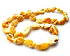 raw butterscotch necklace http://amberregina.com/product/baltic-amber-raw-butterscotch-necklace-24-5-27-1-gram/
