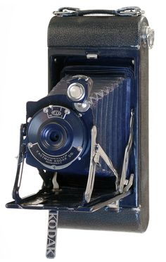 Kodak Pocket Junior No.1A (Blue) Circa 1930   This example is of the rare blue version with matching colored bellows.    Note the newer style Art Deco lettering on the flip-out stand under the door.   Over 200 more vintage cameras at: http://www.web4homes.com/cameras
