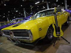 Curious? Yellow Charger R/T and matching guitar from G&L Musical Instruments.