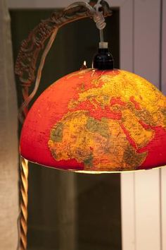 A vintage globe repurposed as a reading lamp. See more Junk Gypsy designs http://www.gactv.com/gac/shows_hjkgp/article/0,3561,GAC_45849_6067523_126,00.html