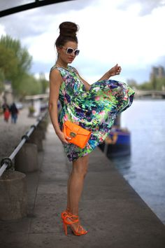blown away by this colorful look, floral dress in greens and blues, orange clutch and shoes