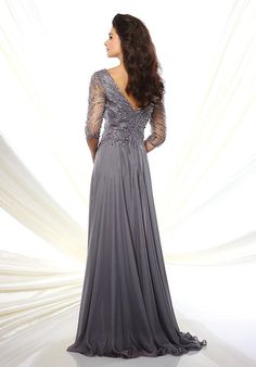 Diamond chiffon A-line gown with hand-beaded three-quarter length sleeves, front and back V-necklines, bodice encrusted with beading, flyaway skirt with sweep train.